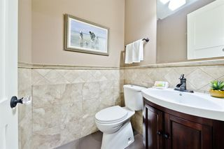 Photo 3: 57 QUARRY Way SE in Calgary: Douglasdale/Glen Detached for sale : MLS®# A1019379