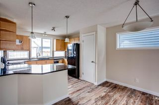 Photo 7: 90 Auburn Bay Manor SE in Calgary: Auburn Bay Detached for sale : MLS®# A1049204