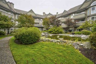 "Photo 1: 113 12088 66 Avenue in Surrey: West Newton Condo for sale in ""Lakewood Terrace"" : MLS®# R2498252"