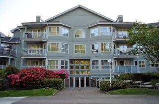 Photo 1: 209 13939 LAUREL Drive in Surrey: Whalley Condo for sale (North Surrey)  : MLS®# F1213183
