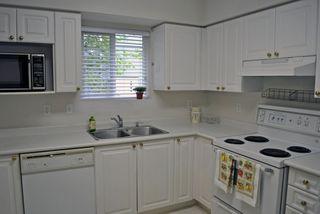 Photo 6: 209 13939 LAUREL Drive in Surrey: Whalley Condo for sale (North Surrey)  : MLS®# F1213183