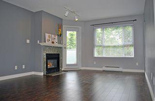 Photo 2: 209 13939 LAUREL Drive in Surrey: Whalley Condo for sale (North Surrey)  : MLS®# F1213183