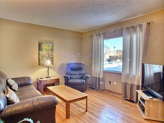 Photo 5: 408 Woodward Avenue in Winnipeg: Fort Rouge / Crescentwood / Riverview Residential for sale (Riverview)  : MLS®# 1301173