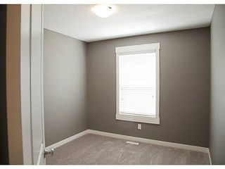Photo 12: 452 Rainbow Falls Drive: Chestermere Townhouse for sale : MLS®# C3579282