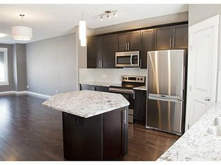 Photo 2: 452 Rainbow Falls Drive: Chestermere Townhouse for sale : MLS®# C3579282