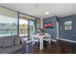 Photo 5: 407 301 CAPILANO ROAD in Port Moody: Port Moody Centre Condo for sale : MLS®# R2266488
