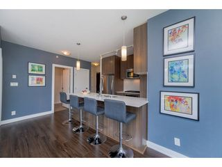 Photo 4: 407 301 CAPILANO ROAD in Port Moody: Port Moody Centre Condo for sale : MLS®# R2266488