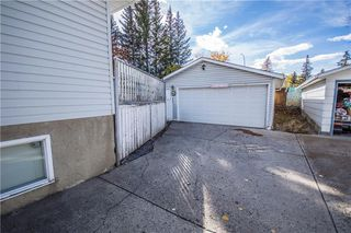 Photo 3: 515 WOODPARK CR SW in Calgary: Woodlands House for sale : MLS®# C4209473