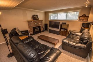 Photo 18: 515 WOODPARK CR SW in Calgary: Woodlands House for sale : MLS®# C4209473