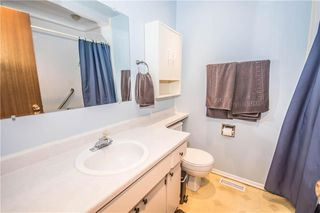 Photo 16: 515 WOODPARK CR SW in Calgary: Woodlands House for sale : MLS®# C4209473