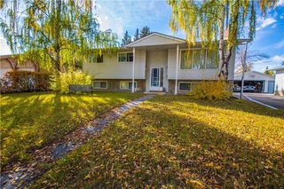 Photo 2: 515 WOODPARK CR SW in Calgary: Woodlands House for sale : MLS®# C4209473