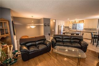 Photo 8: 515 WOODPARK CR SW in Calgary: Woodlands House for sale : MLS®# C4209473