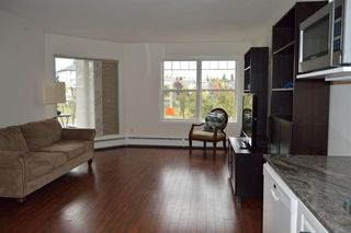 Photo 3: 312 7 Somervale View SW in Calgary: Somerset Apartment for sale : MLS®# A1050911