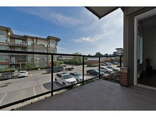 "Photo 2: 202 33539 HOLLAND Avenue in Abbotsford: Central Abbotsford Condo for sale in ""The Crossing - Building B"" : MLS®# R2517839"