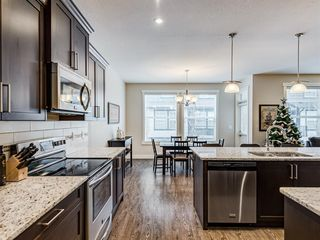 Photo 7: 203 110 Coopers Common SW: Airdrie Row/Townhouse for sale : MLS®# A1055998