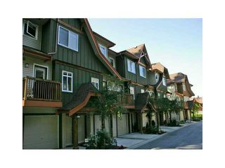 """Photo 1: 106 2000 PANORAMA Drive in Port Moody: Heritage Woods PM Townhouse for sale in """"MOUNTAINS EDGE"""" : MLS®# V962852"""