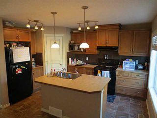 Photo 2: 322 Mcleod Crescent: Turner Valley Half Duplex for sale : MLS®# C3583898