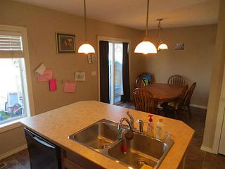 Photo 5: 322 Mcleod Crescent: Turner Valley Half Duplex for sale : MLS®# C3583898