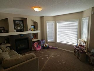 Photo 6: 322 Mcleod Crescent: Turner Valley Half Duplex for sale : MLS®# C3583898