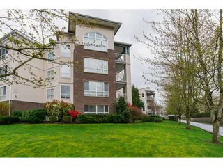 Photo 2: 308 20200 54A AVENUE in Langley: Langley City Condo for sale : MLS®# R2221595