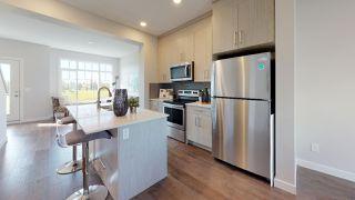 Photo 2: 11 11373 12 Avenue in Edmonton: Zone 16 Townhouse for sale : MLS®# E4173420