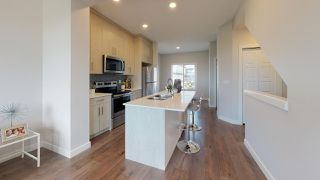 Photo 3: 11 11373 12 Avenue in Edmonton: Zone 16 Townhouse for sale : MLS®# E4173420