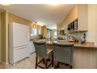 """Photo 8: 15851 NORFOLK Road in Surrey: King George Corridor Manufactured Home for sale in """"CRANLEY PARK"""" (South Surrey White Rock)  : MLS®# R2428769"""