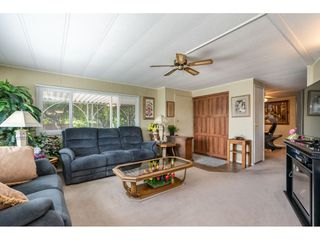 """Photo 3: 15851 NORFOLK Road in Surrey: King George Corridor Manufactured Home for sale in """"CRANLEY PARK"""" (South Surrey White Rock)  : MLS®# R2428769"""