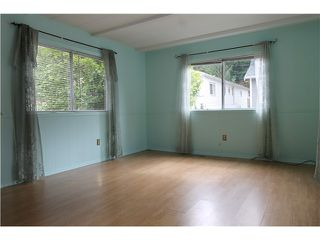 "Photo 2: 54 3295 SUNNYSIDE Road: Anmore Manufactured Home for sale in ""COUNTRYSIDE VILLAGE"" (Port Moody)  : MLS®# V999785"