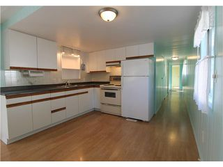 "Photo 3: 54 3295 SUNNYSIDE Road: Anmore Manufactured Home for sale in ""COUNTRYSIDE VILLAGE"" (Port Moody)  : MLS®# V999785"