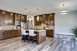 Photo 4: 83 ASPEN STONE Manor SW in Calgary: Aspen Woods Detached for sale : MLS®# C4259522
