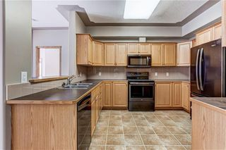Photo 5: 2355 151 COUNTRY VILLAGE Road NE in Calgary: Country Hills Village Apartment for sale : MLS®# C4305451
