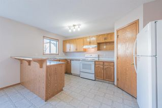 Photo 7: 223 Arbour Meadows Close NW in Calgary: Arbour Lake Detached for sale : MLS®# A1044166