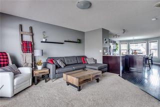Photo 2: 220 AUTUMN Green SE in Calgary: Auburn Bay Detached for sale : MLS®# A1050487