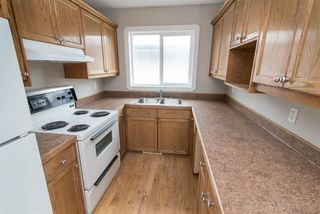 Photo 9: 11721 80 Street in Edmonton: Zone 05 House Duplex for sale : MLS®# E4176886