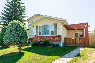 Main Photo: 534 QUEENSLAND Place SE in Calgary: Queensland Semi Detached for sale : MLS®# A1020359