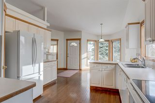Photo 7: 25 Strathearn Gardens SW in Calgary: Strathcona Park Semi Detached for sale : MLS®# A1045110