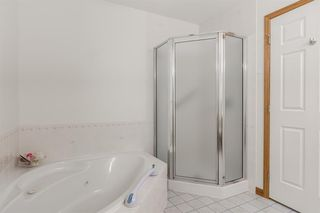 Photo 19: 25 Strathearn Gardens SW in Calgary: Strathcona Park Semi Detached for sale : MLS®# A1045110