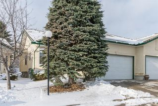 Main Photo: 25 Strathearn Gardens SW in Calgary: Strathcona Park Semi Detached for sale : MLS®# A1045110