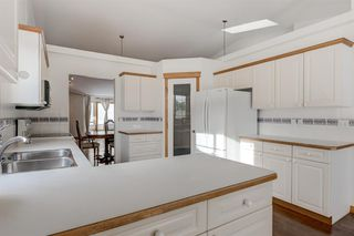 Photo 5: 25 Strathearn Gardens SW in Calgary: Strathcona Park Semi Detached for sale : MLS®# A1045110