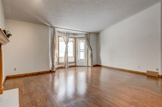 Photo 13: 25 Strathearn Gardens SW in Calgary: Strathcona Park Semi Detached for sale : MLS®# A1045110