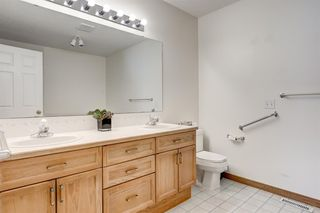 Photo 18: 25 Strathearn Gardens SW in Calgary: Strathcona Park Semi Detached for sale : MLS®# A1045110