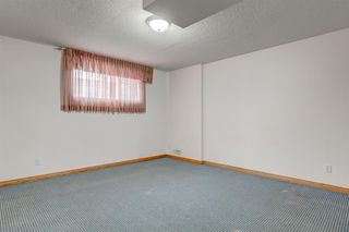 Photo 26: 25 Strathearn Gardens SW in Calgary: Strathcona Park Semi Detached for sale : MLS®# A1045110