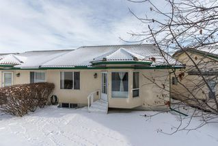 Photo 32: 25 Strathearn Gardens SW in Calgary: Strathcona Park Semi Detached for sale : MLS®# A1045110