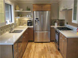 """Photo 1: 2915 ARGO Place in Burnaby: Simon Fraser Hills Townhouse for sale in """"SMON FRASER HILLS"""" (Burnaby North)  : MLS®# V947178"""