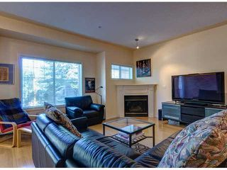 Photo 2: 122 1110 5 Avenue NW in CALGARY: Hillhurst Townhouse for sale (Calgary)  : MLS®# C3584340
