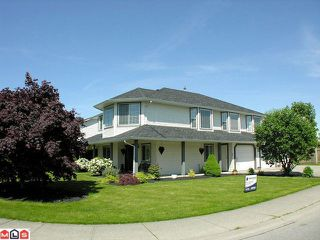 "Photo 1: 34687 6TH Avenue in Abbotsford: Poplar House for sale in ""Huntingdon"" : MLS®# F1212007"