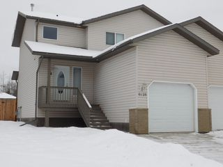 Photo 1: 3 Bedroom half Duplex in Westgrove area of Edson, AB