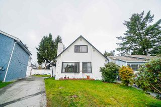 """Photo 1: 12906 72A Avenue in Surrey: Queen Mary Park Surrey House for sale in """"West Newton"""" : MLS®# R2425291"""