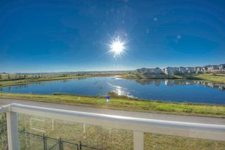 Photo 15: 550 Redstone View NE in Calgary: Redstone Row/Townhouse for sale : MLS®# A1038452